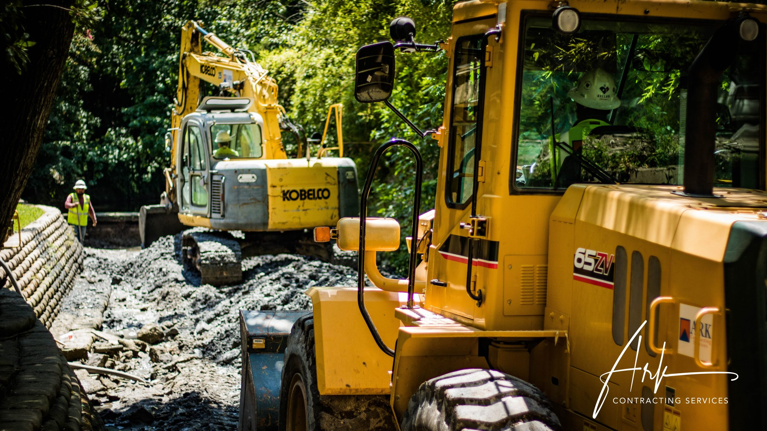 Ark Contracting Services performing an excavation in a neighborhood in the Dallas / Ft. Worth area in Texas.